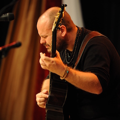 Caption: Master guitarist Andy McKee on the WoodSongs Stage.