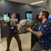 Caption: Rosetta Mission Manager Patrick Martin and Project Scientist Matt Taylor simulate the spacecraft touchdown at Planetary Society HQ., Credit: Mat Kaplan