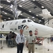 "Caption: Enrico Palermo and host Mat Kaplan pose in front of the ""feathered"" VSS Unity, SpaceShipTwo, Credit: Enrico Palermo for The Spaceship Company"
