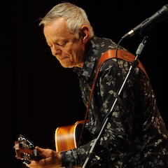 Caption: Guitar master Tommy Emmanuel returns to the WoodSongs Stage.