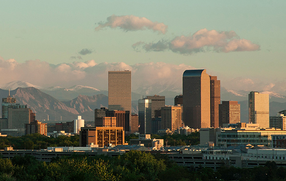 Caption: Denver Colorado sits before a spread of cloud kissed Rocky Mountains., Credit: Sheila Sund/Flickr