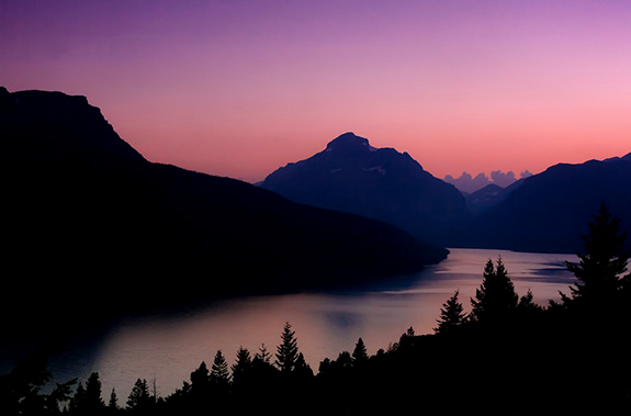 Caption: A beautiful sunset graces Two Medicine Lake and Sinopah Mountain in Montana. , Credit: Ryan McKee/Flickr