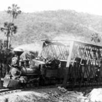 Caption: Mexico - Railroad scenes: Train crossing bridge at Crucitas, Credit: Photo by W.H. Jackson