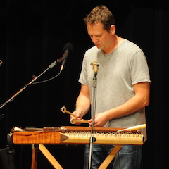 Caption: Ted Yoder on the hammered dulcimer.