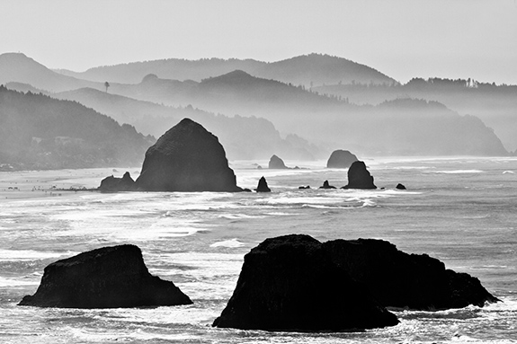 Caption: Oregon's rugged coastline is rendered in black and white with a range of depths exhibiting difference ranges of darkness., Credit: Ian Sane/Flickr
