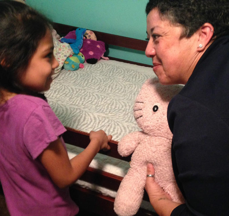Caption: Sarai (left) and her teacher Esther Martinez, Credit: Bill Zeeble