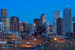 Caption: A skyline shot of Denver at sunset against a dusky blue sky., Credit: Larry Johnson/Flickr