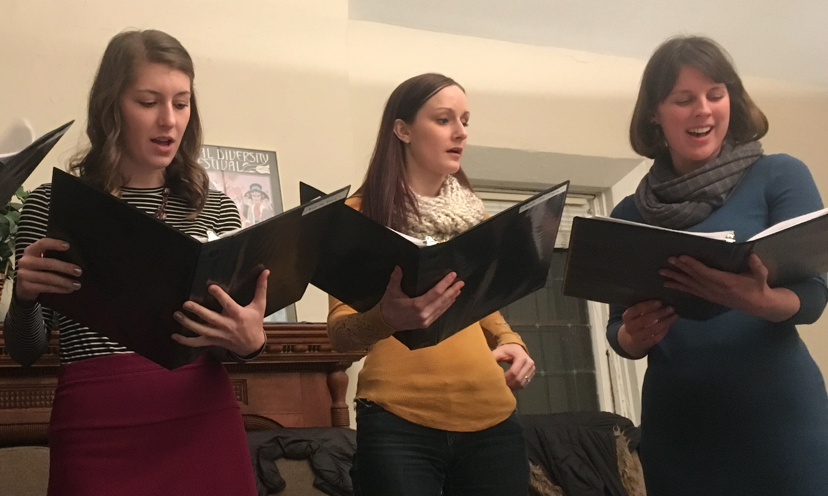 Caption: Laura Linder-Scholer, Julia Bodin and Sarah Super at a Survivor Voices choir rehearsal., Credit: Sophie Nikitas