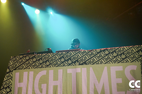Caption: A DJ spins a record at a High Times table at a Cannabis Cup., Credit: Cannabis Culture/Flickr