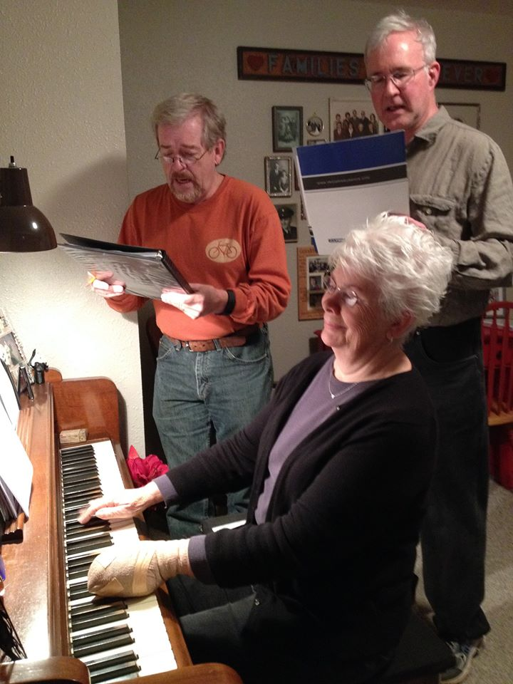 Caption: Community members rehearse musical numbers for November's show!