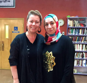 Caption: Melanie and Emane (Houda's mother) at the potluck where they first met in August, 2016, two weeks after Houda's family arrived in Tucson.