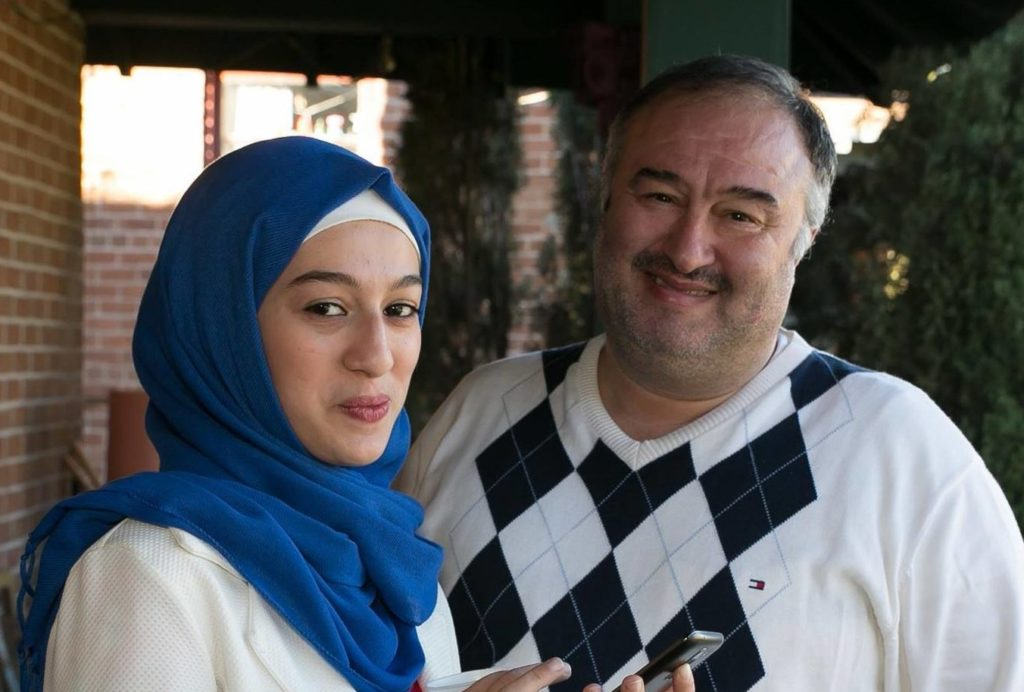 Caption: Houda and her dad, Houssam, on the porch at KXCI, Credit: Kathleen Dreier Photography
