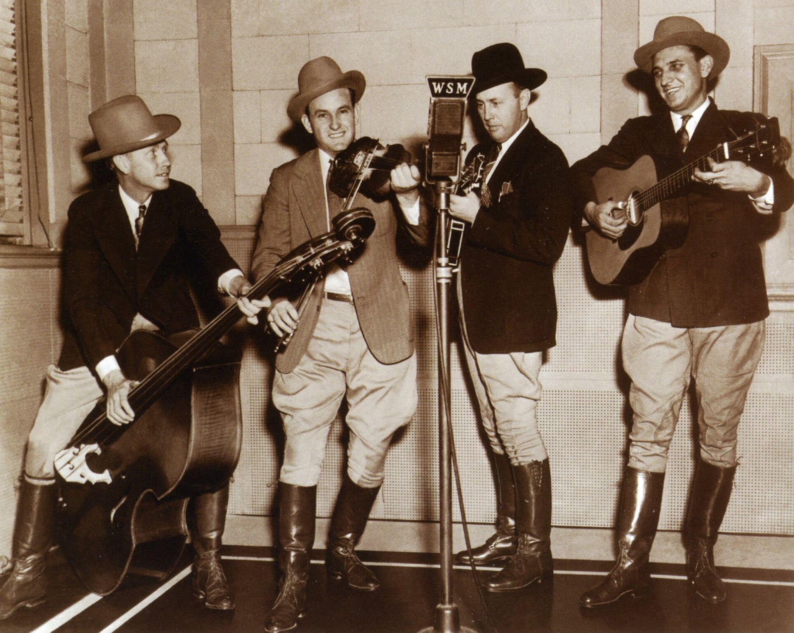 Caption: Bill Monroe (second from right) and His Blue Grass Boys were early Grand Ole Opry stars who refashioned mountain music into the new genre called bluegrass. , Credit: nativeground.com
