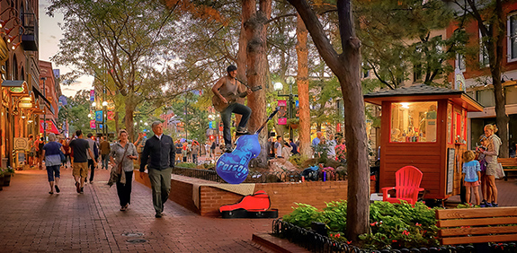 Caption: An afternoon shot of Boulder's Pearl Street walking mall shows pedestrians strolling along the bricks as buskers perform all around. , Credit: Pedro Szekely/Flickr