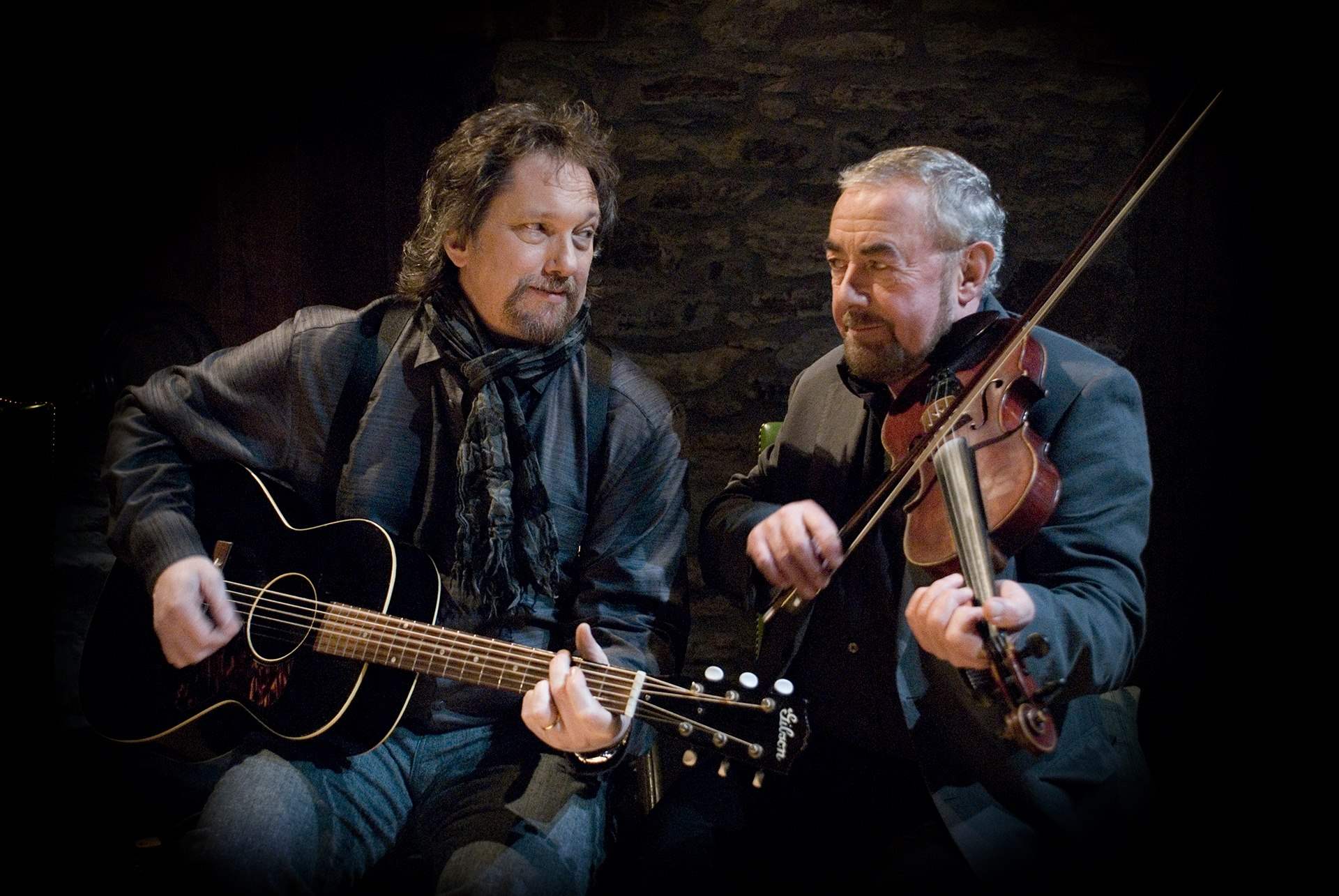 Caption: Jerry Douglas (l.) and Aly Bain host the Transatlantic Sessions, in the U.S. for the first time this year.  One stop will be Merlefest in North Carolina.  , Credit: Merlefest