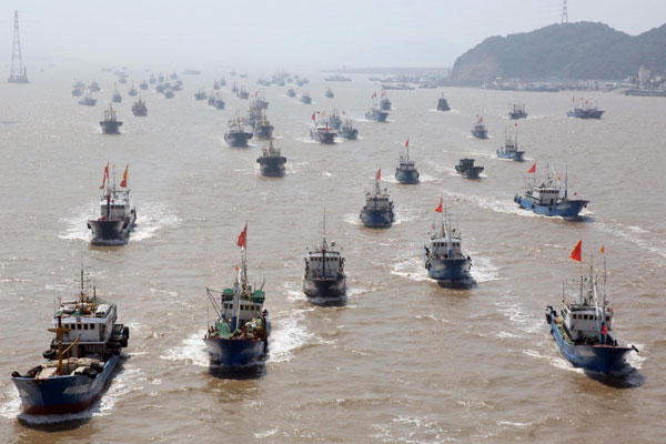 Caption: Fishing vessels set out from Shenjiamen Port in Zhoushan city, East China's Zhejiang province., Credit: Xinhua | Liang Minhui