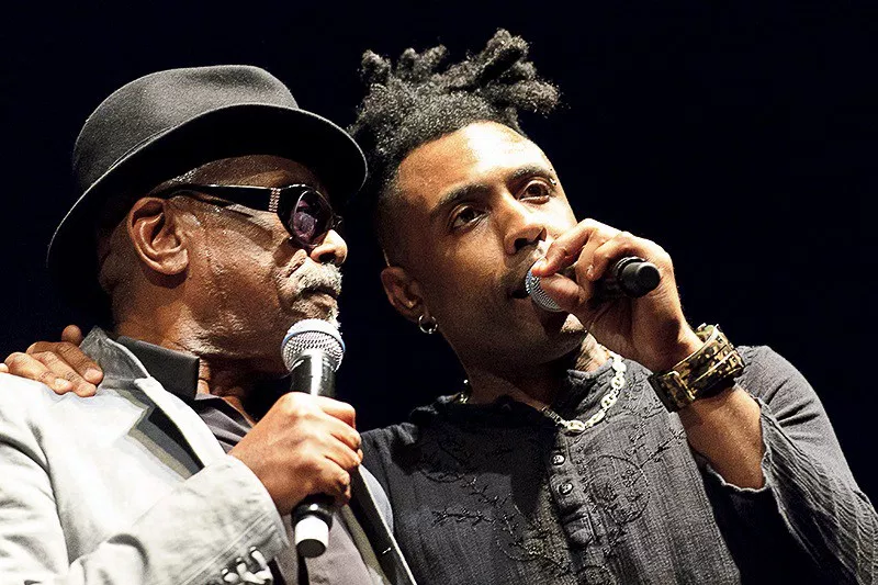 Caption: Omar with Leon Ware
