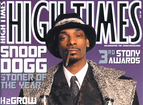 Caption: Snoop Dogg graces a purple cover of High Times Magazine with blunt hanging from his mouth. , Credit: High Times Magazine