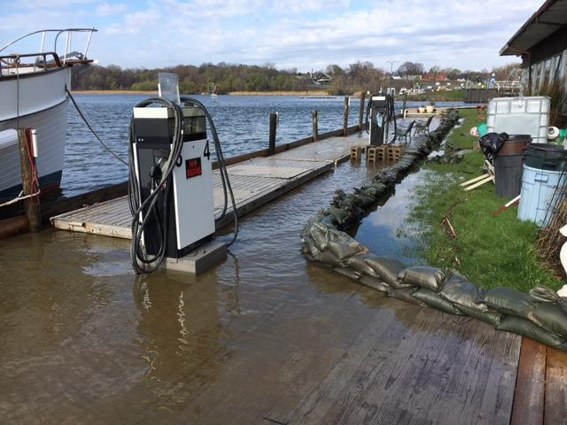 Caption: Flooded gas dock at a marina in Rochester, New York, Credit: Alex Crichton, WXXI News