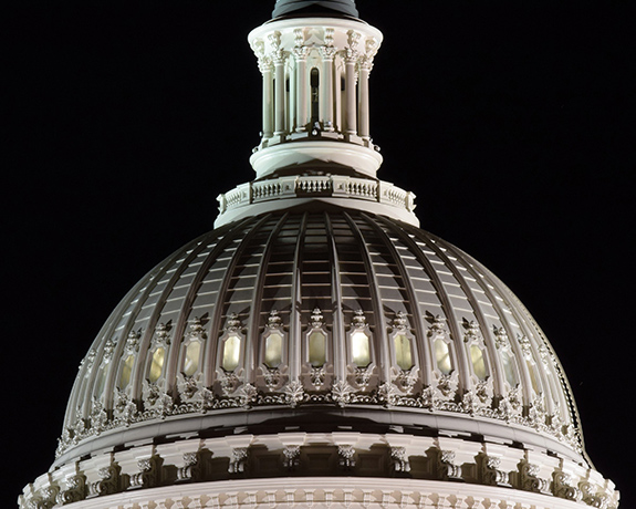 Caption: The US Capitol Building is brightly lit in this close- up shot taken at night., Credit: Dan Grogan/Flickr
