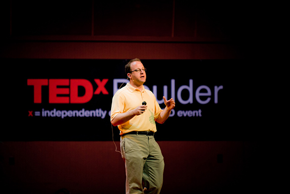 Caption: Congressman Jared Polis speaks on stage at TEDxBoulder., Credit: Brandon Harper/Flickr