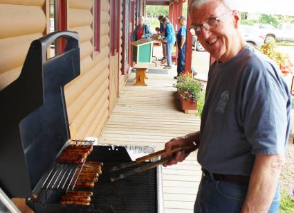 Caption: Fred Smith, Wildersmith on the Gunflint, on the grill at the WTIP summer pledge drive