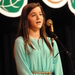 Caption: Our WoodSongs Kid Maddie Carbary performs on the WoodSongs Stage.