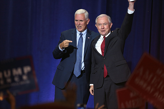 Caption: Attorney General Jeff Sessions and Vice President Mike Pence wave to a crowd while up on stage., Credit: Gage Skidmore/Flickr
