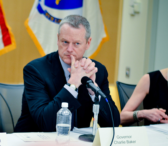 Caption: Massachusetts governor Charlie Baker listens to someone speak while sitting on a panel discussion., Credit: Executive Office of Health and Human Services/Flickr