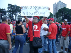 Caption: A Chavez supporter holds a sign during a rally in Caracas, Credit: Ruxandra Guidi