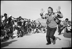 Caption: Moises Tiana during a clown performance in Pisco, Peru, Credit: Roberto &quot;Bear&quot; Guerra