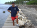Caption: Ben Chutaro on edge of Jablik Dump, Majuro, Credit: David Kattenburg