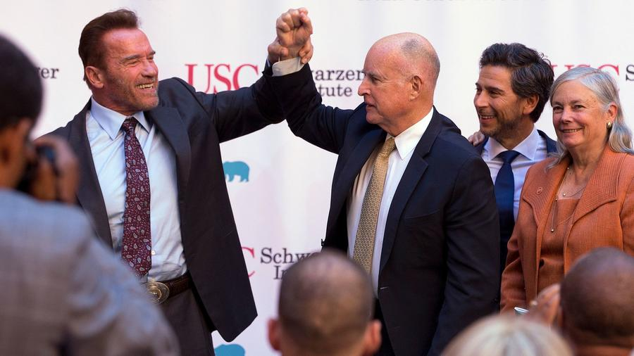 Caption: Former Gov. Arnold Schwarzenegger, left, a Republican, and Democratic Gov. Jerry Brown, shown last year, are both cap-and-trade proponents. , Credit: Rich Pedroncelli / Associated Press