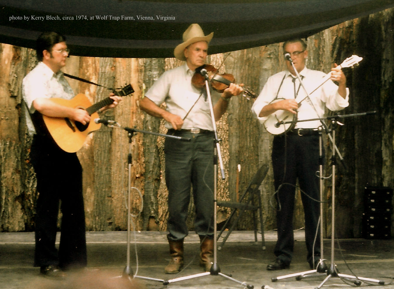 Caption: Bobby Patterson (left), Kyle Creed (center) and Fred Cockerham at Wolf Trap Farm Park, Vienna, VA.  c. 1974.  Patterson was an outstanding musician from the tradition-rich Galax, Virginia area, and was also dedicated to recording music of the region and m, Credit: Kerry Blech, used with permission