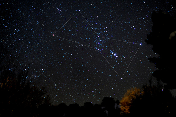 Caption: A night sky is filled with stars and overdrawn with lines showing the Orion constellation., Credit: Theilr/Flickr