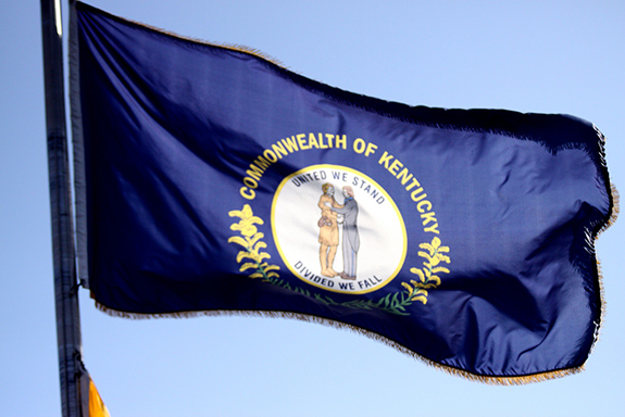 Caption: The Kentucky state flag is coated in sunlight as it waves in the wind. , Credit: Gage Skidmore/Flickr