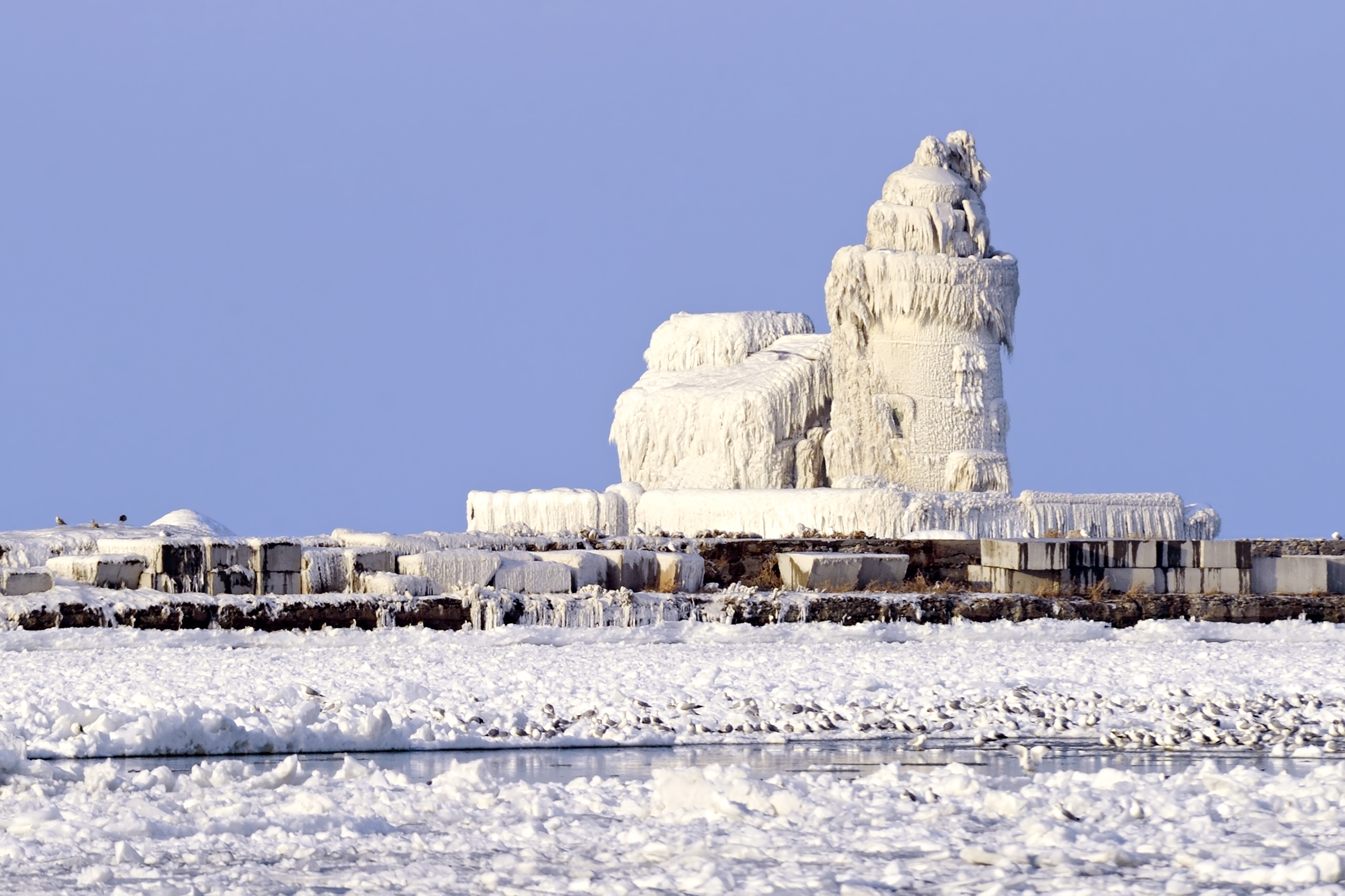 Caption: The Cleveland Harbor West Pierhead Lighthouse covered in ice, Credit: Amy Nichole Harris/Shutterstock