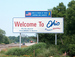 Caption: A roadsign sign reads 'Welcome to Ohio'., Credit: bearclau/Flickr