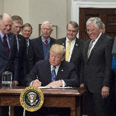 Caption: Representatives of Congress and the National Space Council, along with several astronauts, joined President Donald J. Trump, for the president's signing of Space Policy Directive 1., Credit: NASA/Aubrey Gemignani