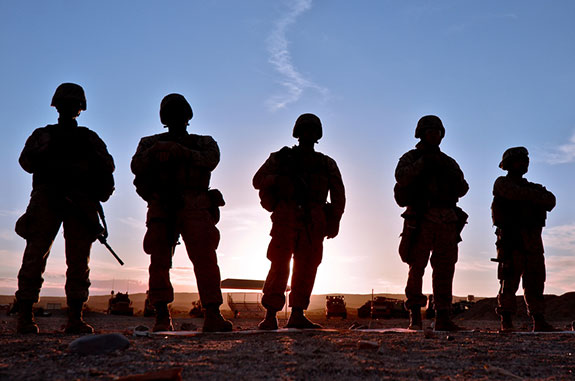 Caption: A silhouetted group of U.S. Marines stands out in the desert., Credit: U.S. Department of Agriculture/Flickr
