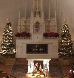 Caption: Mackinac Island's Ste. Anne's Catholic Church decorated for Chirstmast, Credit: Jason Kladiva