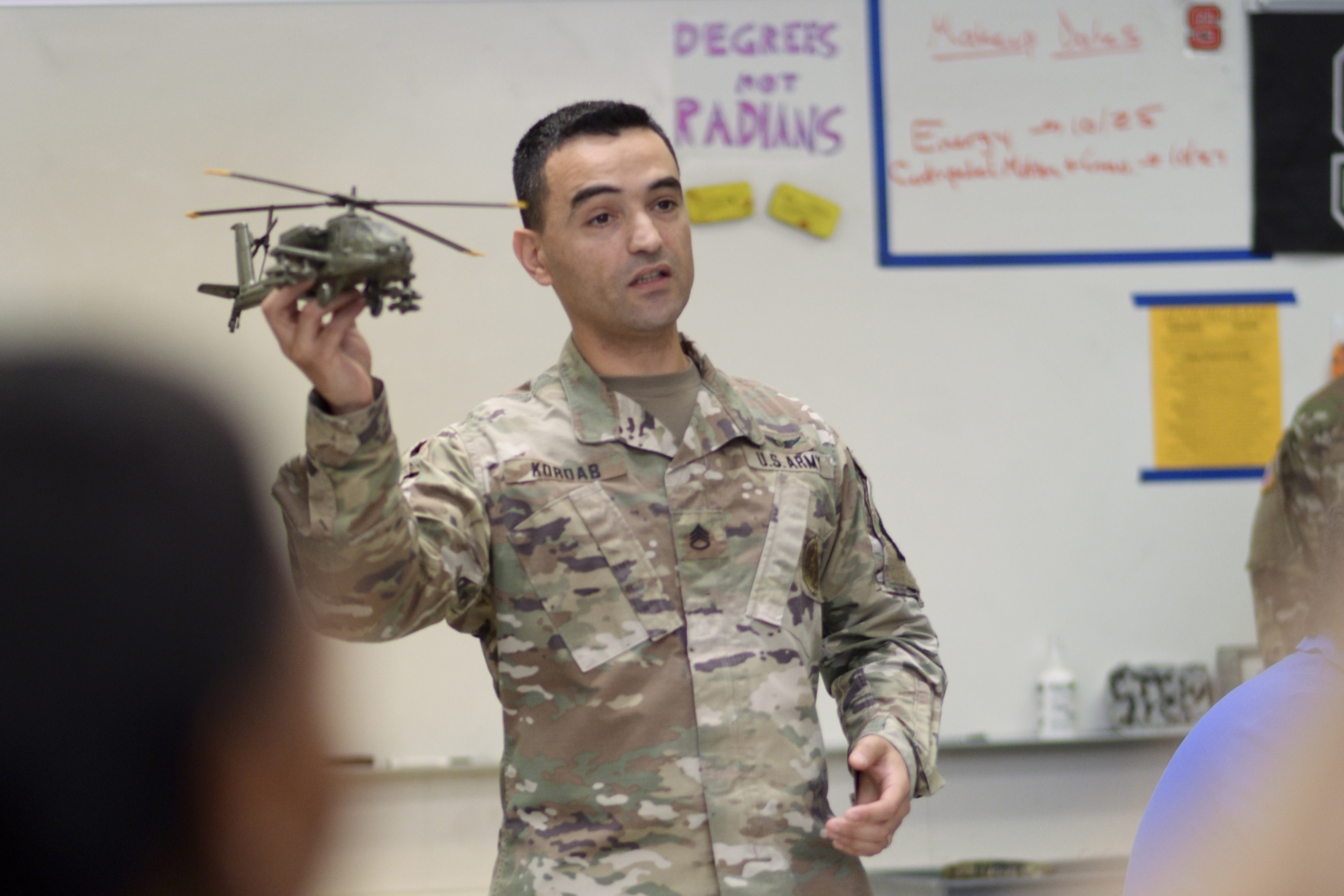Caption: Army Staff Sgt. Bilal Kordab talks about military careers with students at Athens Drive High School in Raleigh, N.C., Credit:  Mary Junell / U.S. Army National Guard