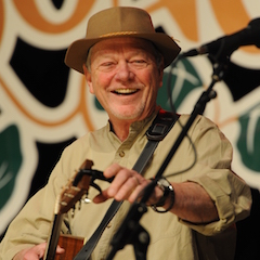 Caption: Rusty Young of Poco performs on the WoodSongs Stage.