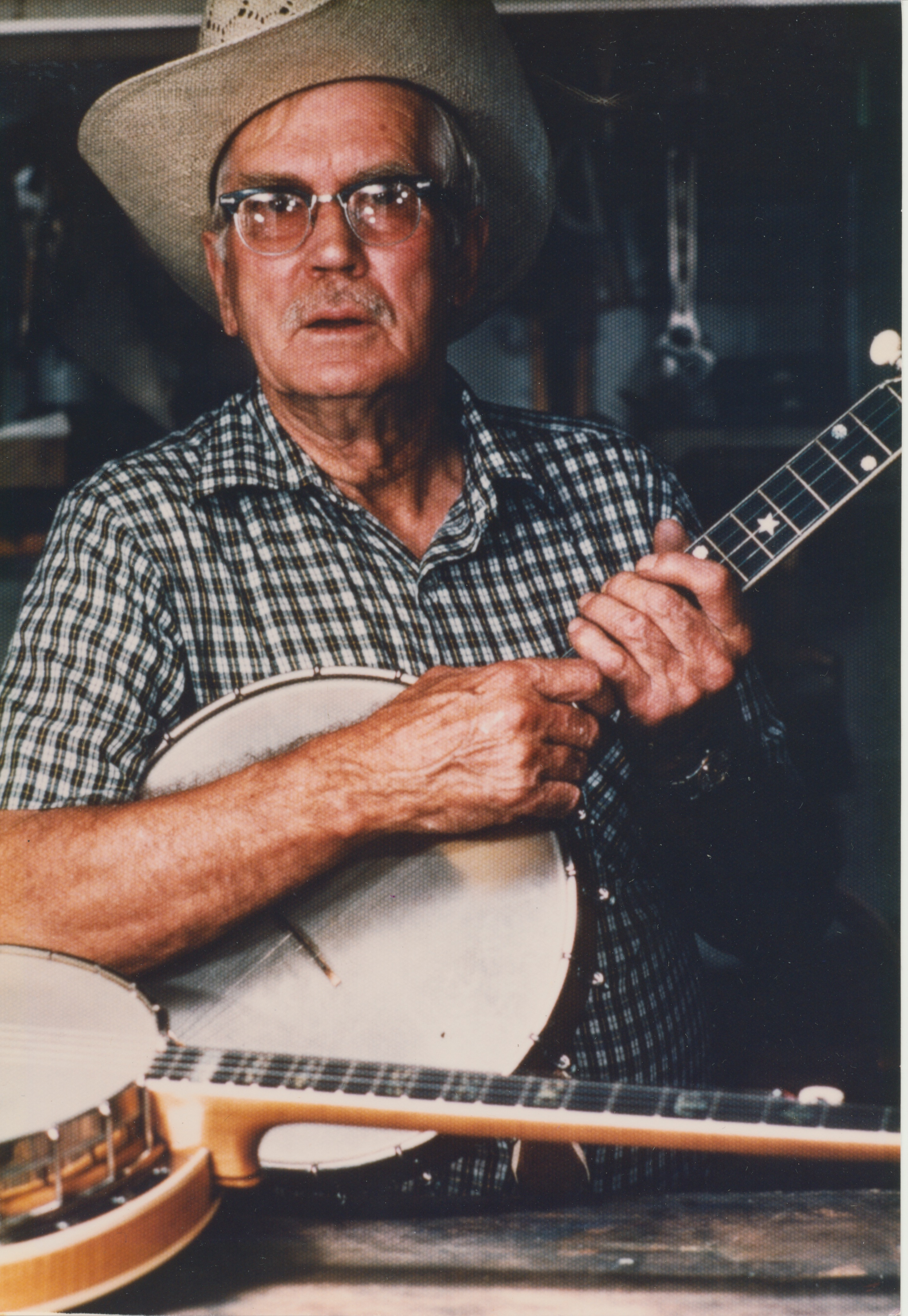 Caption: Kyle Creed was an influential banjo picker, luthier, fiddler and record producer in the Blue Ridge.  We feature him this week with two of his best fiddle tunes – Roscoe and Alabama Gals, both performed with the Camp Creek Boys, including Bobby Patterson o, Credit: Paul Brown