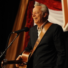 Caption: Tommy Emmanuel back on the WoodSongs Stage.