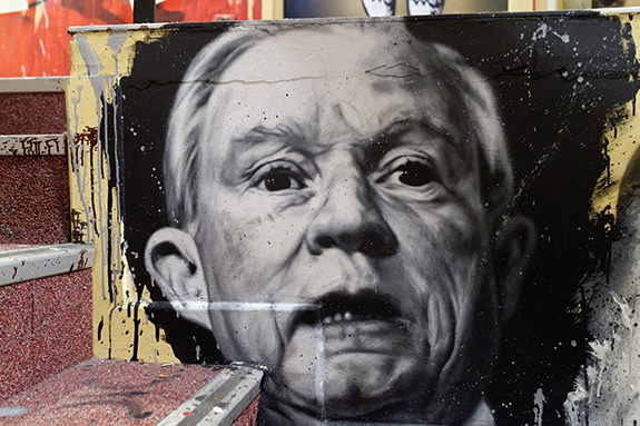 Caption: A painting on a stairway of Jeff Sessions face in black and white looking consternated., Credit: Thierry Ehrmann/Flickr