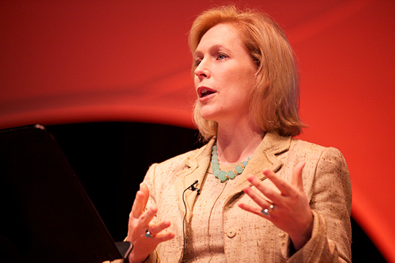 Caption: A close up shot of New York Senator Kirsten Gillibrand speaking on stage at an event., Credit: Personaldemocracy/Flickr