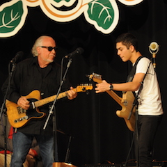 Caption: WoodSongs Kid David Julia performs with legendary bluesman Bob Margolin.