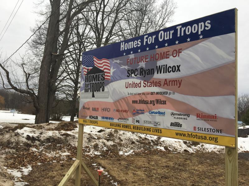 Caption: A charity called 'Homes for Our Troops' is building an accessible home for veteran Ryan Wilcox in upstate New York., Credit: Sarah Harris/American Homefront