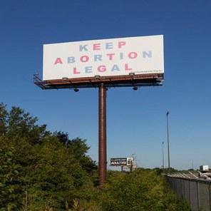"Caption: Aleksandra Mir, ""Keep Abortion Legal,""  June-July 2017 View of installation at I-70 West mile 101,  near Boonville, Credit: Matt Rahner"